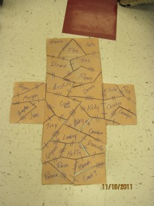 Rebecca's class completes a cross puzzle.  Is your name written on the cross?  Is your name written in the Lamb's Book of Life?