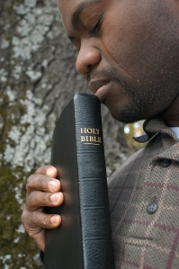 Man prays tears Bible _000001021754Small[1]